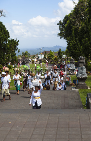 indonesia people carrying religious offerings in