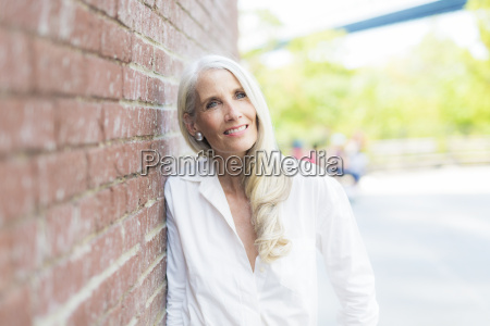 portrait of smiling mature woman wearing