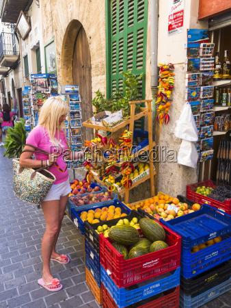 spain mallorca soller woman shopping for