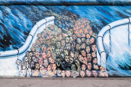 germany berlin mural painting of crowds