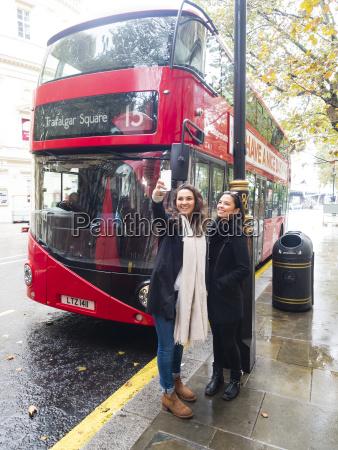uk london two happy friends taking