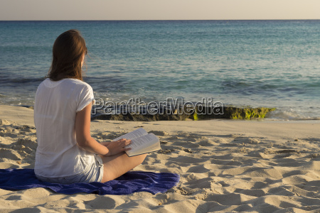 spain formentera woman with book sitting