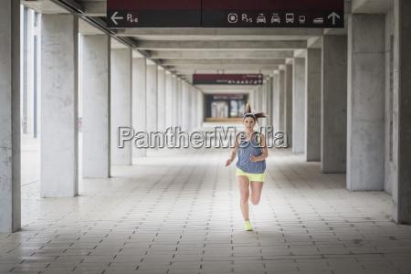 woman running at arcade