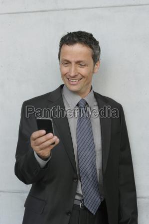 germany bavaria munich businessman using smartphone
