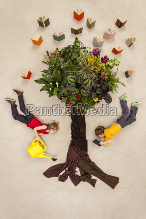 boy and girl watering book tree