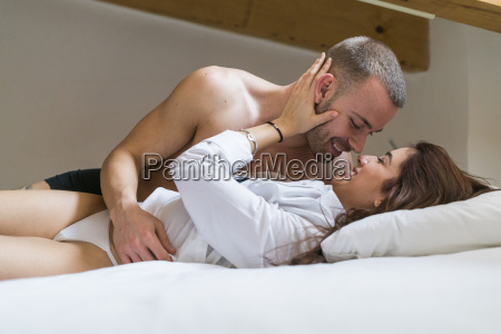 amorous couple touching each other passionately