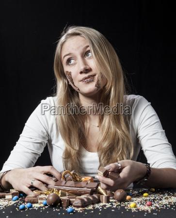 teenage girl eating chocolate