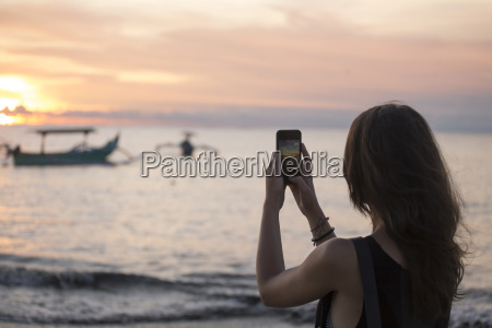 indonesia bali woman taking a picture