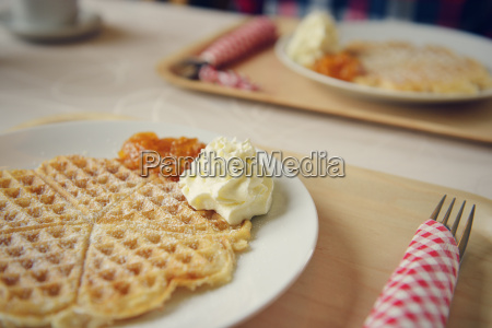 heart shaped waffle with whipped cream