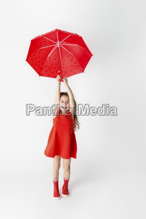 smiling little girl in a red