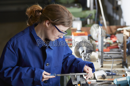 germany kaufbeuren woman working in manufacturing