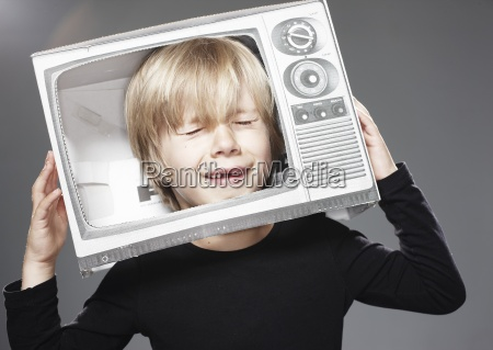 boy crying in paper tv against