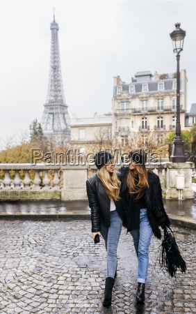 france paris two best friends walking
