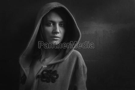portrait of woman wearing hooded jacket