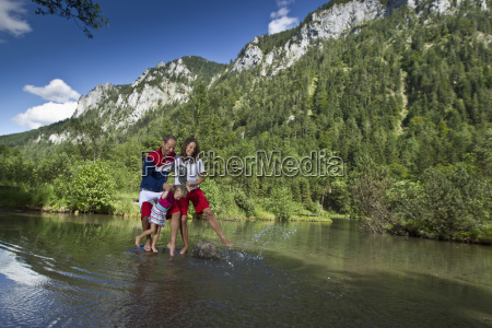germany bavaria chiemgau family crossing mountain