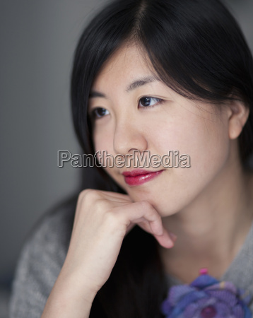 young japanese woman smiling close up