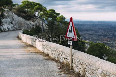spain mallorca felanitx winding road sign