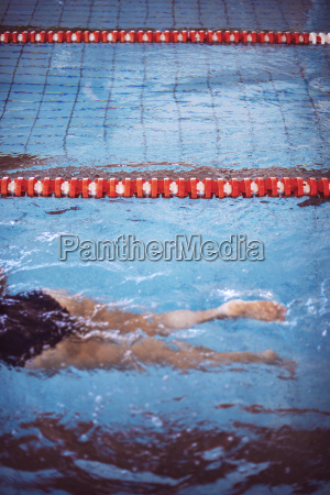 female swimmer in indoor pool