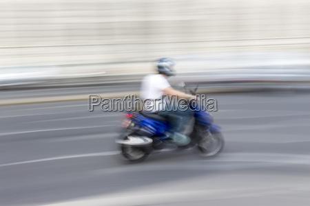 austria vienna scooterist driving on a