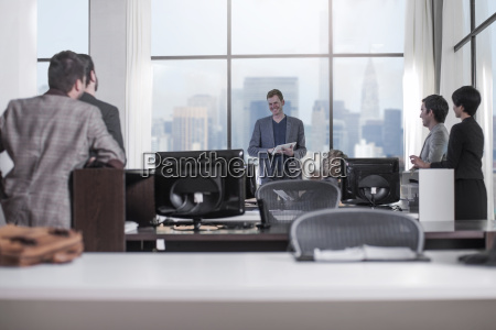 people looking at smiling businessman in