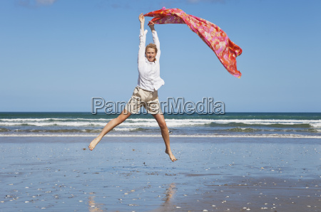 new zealand mature woman jumping at