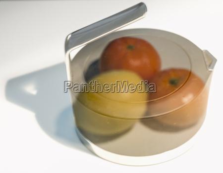 pot with lemon and mandarin oranges