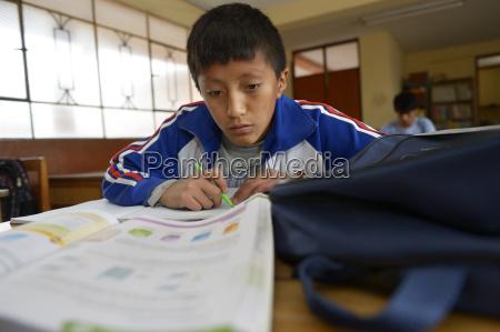 peru ayacucho pupil doing homework in