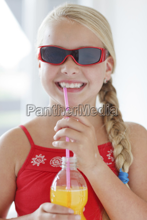 smiling blond girl with soft drink