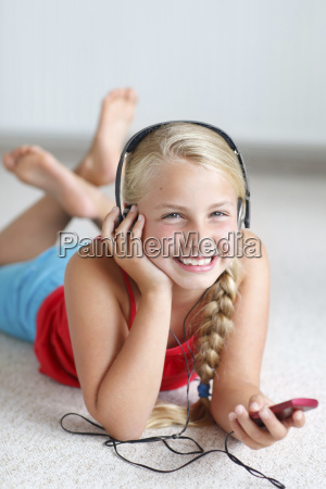 smiling blond girl listening to music