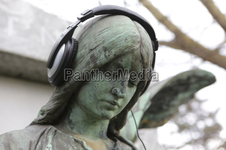 germany cologne angel statue with headphones