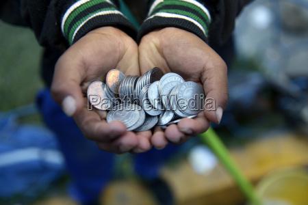 bolivia cochabamba waifs hand full of