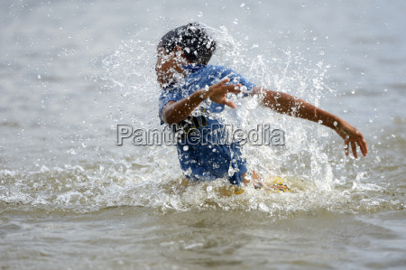 brazil itaituba pimental carefree boy splashing