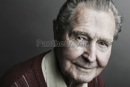 portrait of senior man smiling close