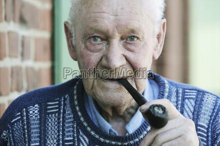 germany portrait of senior man holding