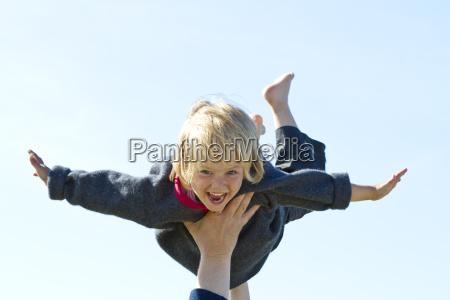 germany girl flying on human hand