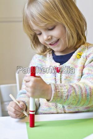 little girl tinkering