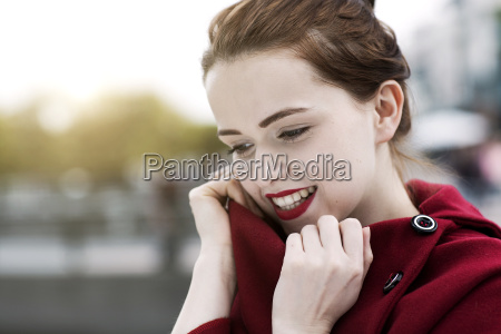 portrait of daydreaming young woman with
