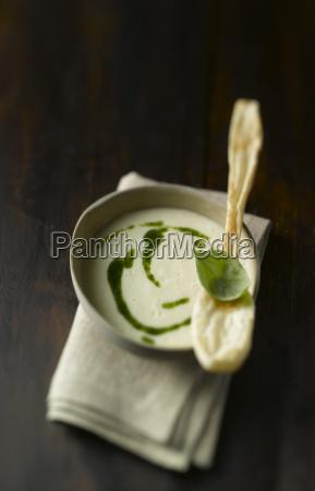 bowl of potato soup with pesto