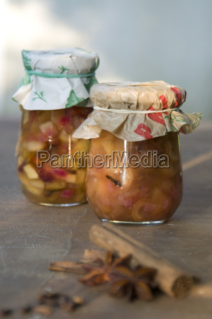 two preserving jars of pear chutney