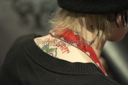 germany young woman with tattoo close