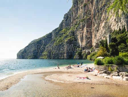 italy lake garda people sunbathing at