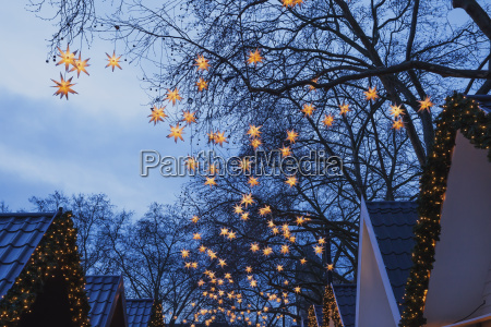 germany christmas market with lighted christmas