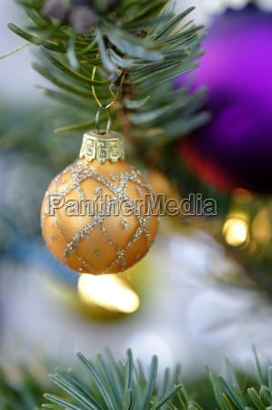 christmas bauble hanging on tree close