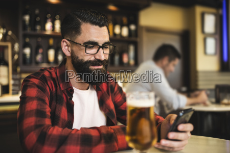 portrait of hipster with glass of