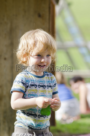 austria boy holding balloon and looking