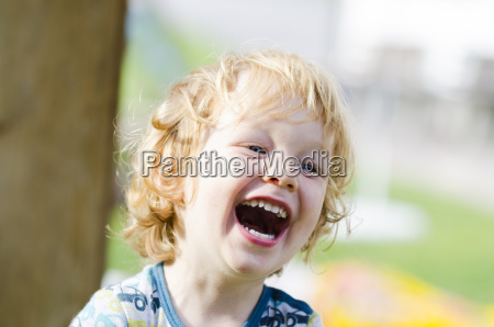 austria boy laughing close up