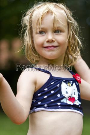 portrait of smiling little girl wearing