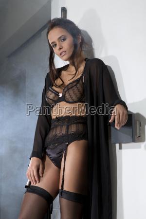 young woman in black lingerie portrait
