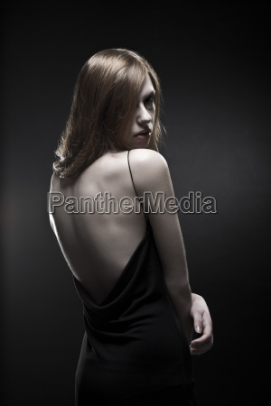 young woman in black dress close