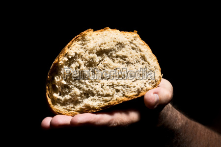 mature man holding bread close up